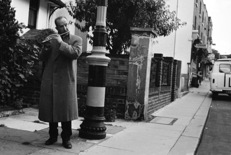 A whistle player on the streets of west London